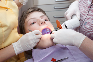 dental treatment with dental curing light